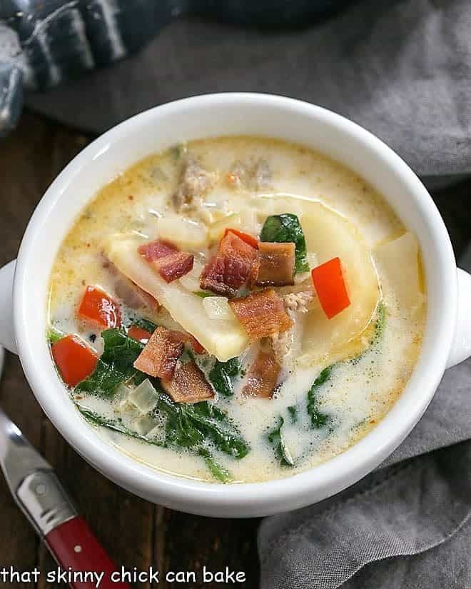 Zuppa Toscana or Tuscan Sausage Soup overhead view in a white soup bowl