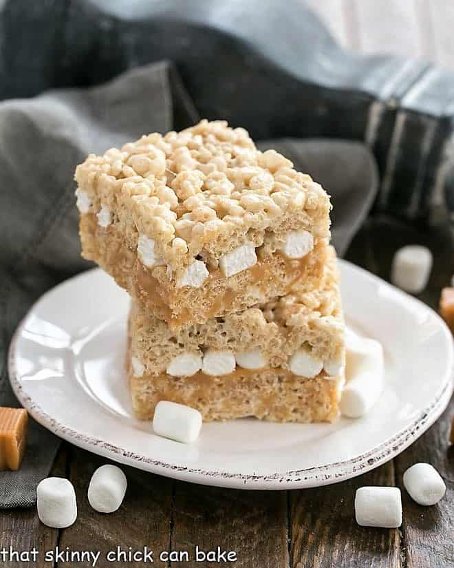 Caramel Stuffed Rice Krispie Treats on a round dessert plate