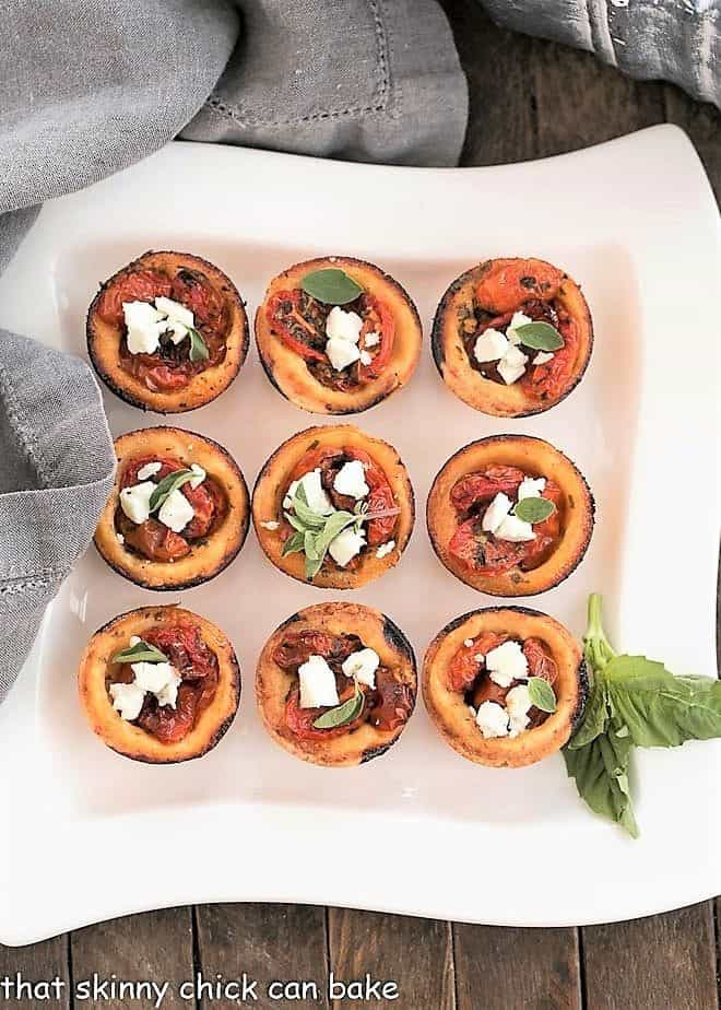 Cheese Straw Tomato Tartlets on a white serving tray