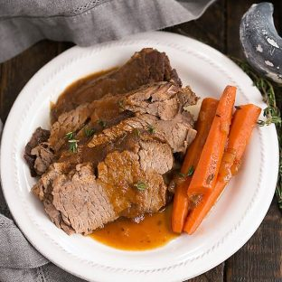 Overhead view of Braised Cola Brisket with Bourbon Gravy on a white plate