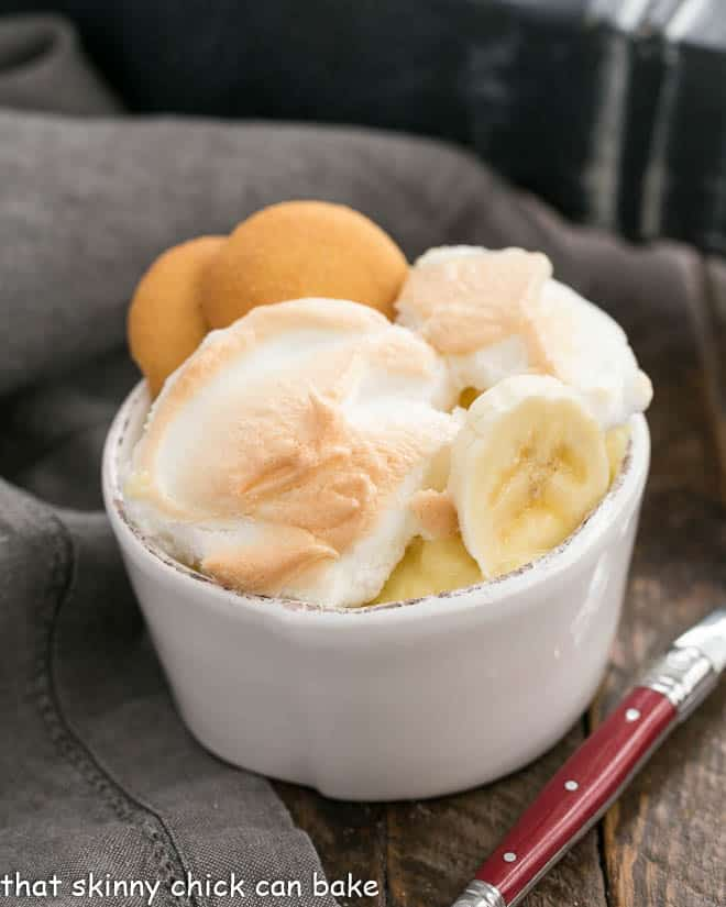 Old-Fashioned Southern Banana Pudding in a white bowl with a red handled spoon