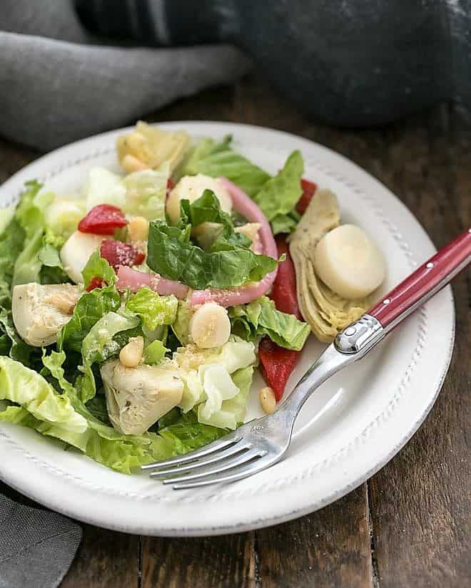 Italian Chopped Salad on a white salad plate with a red handled fork