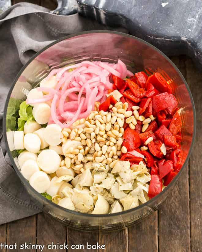 Italian Chopped Salad ingredients in a glass salad bowl