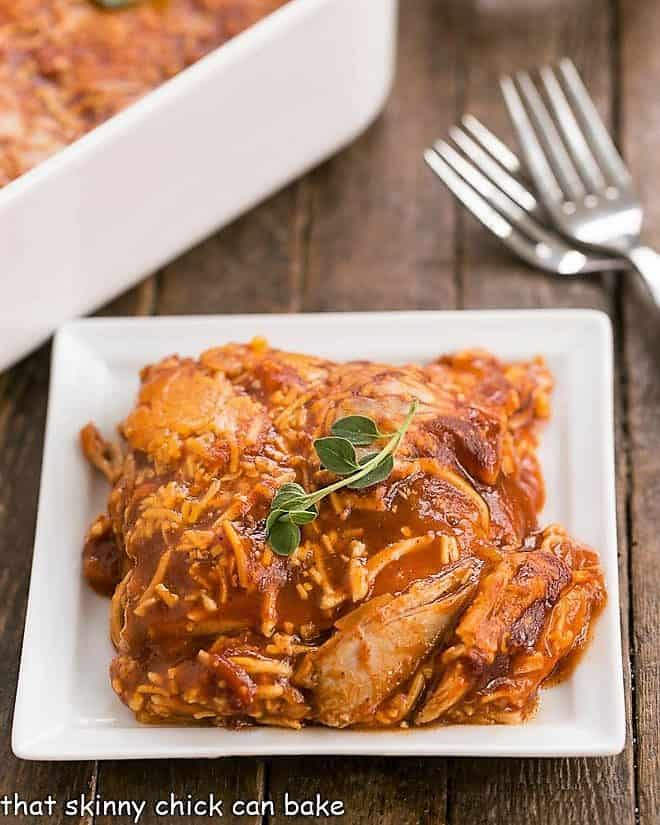 Easy Turkey Enchilada Casserole on a white ceramic plate with forks