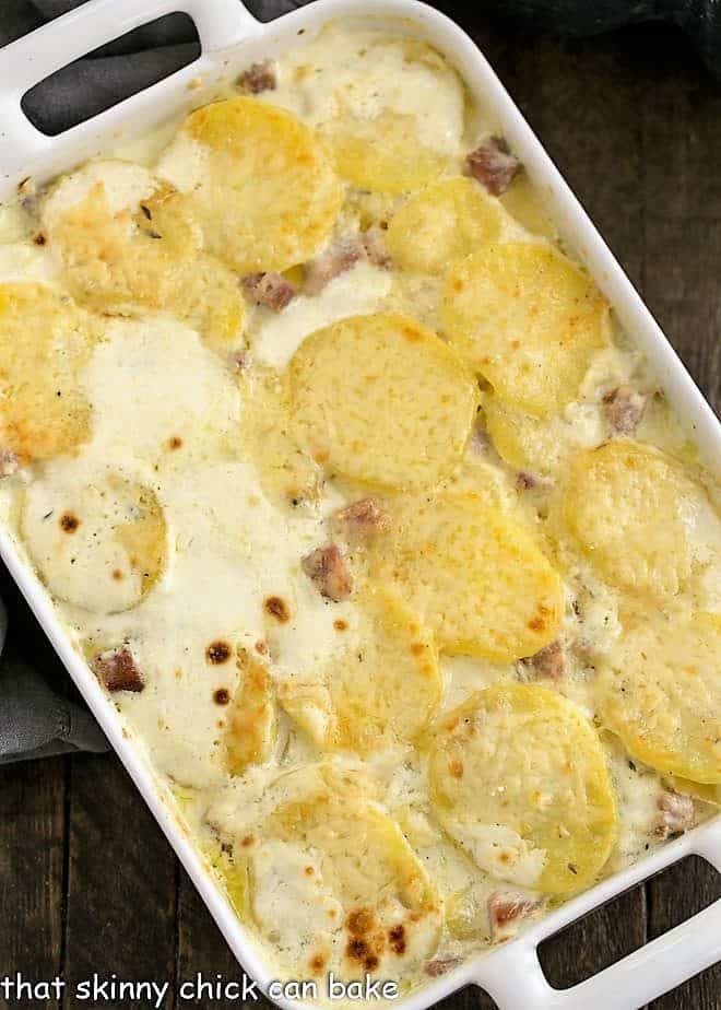 Overhead view of the Best Scalloped Potatoes in a white ceramic casserole dish