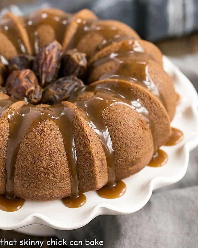 Caramel Topped Date Cake on a white cake stand