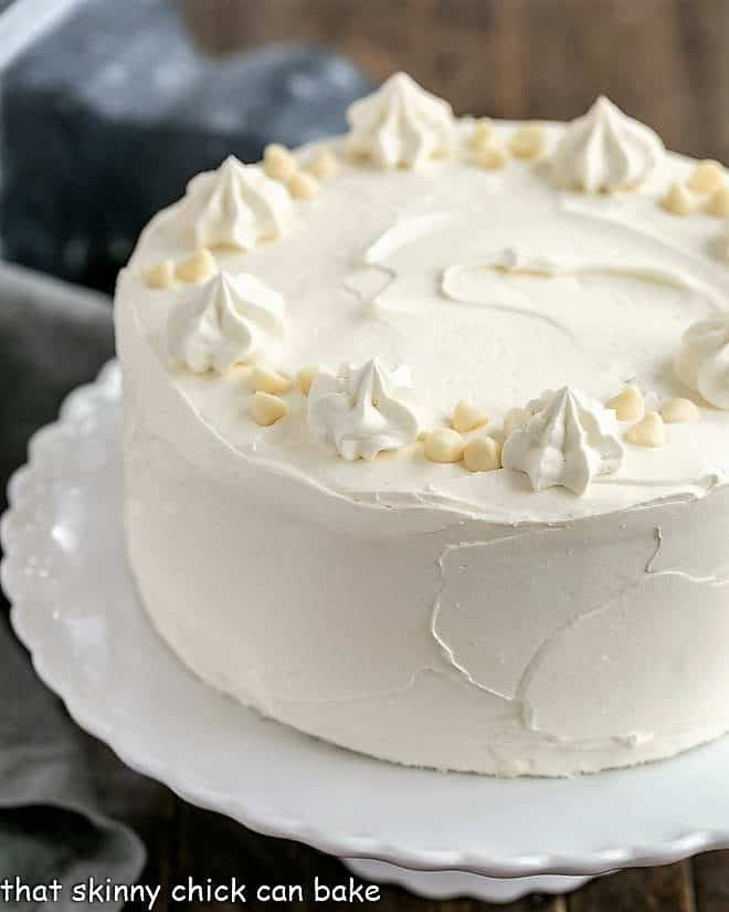 Classic White Layer Cake with White Chocolate Swiss Meringue Buttercream on a white cake stand