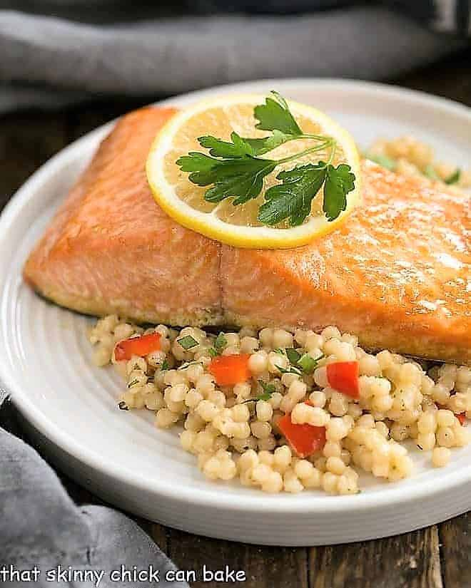 Easy glazed salmon with couscous on a white plate