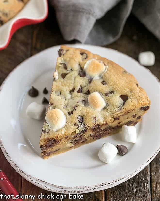 Gooey Chocolate Chip Pie wedge on a white dessert plate with marshmallows and chocolate chips