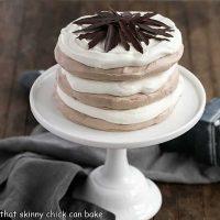 Layered Chocolate Meringue Cake on a white ceramic cake plate