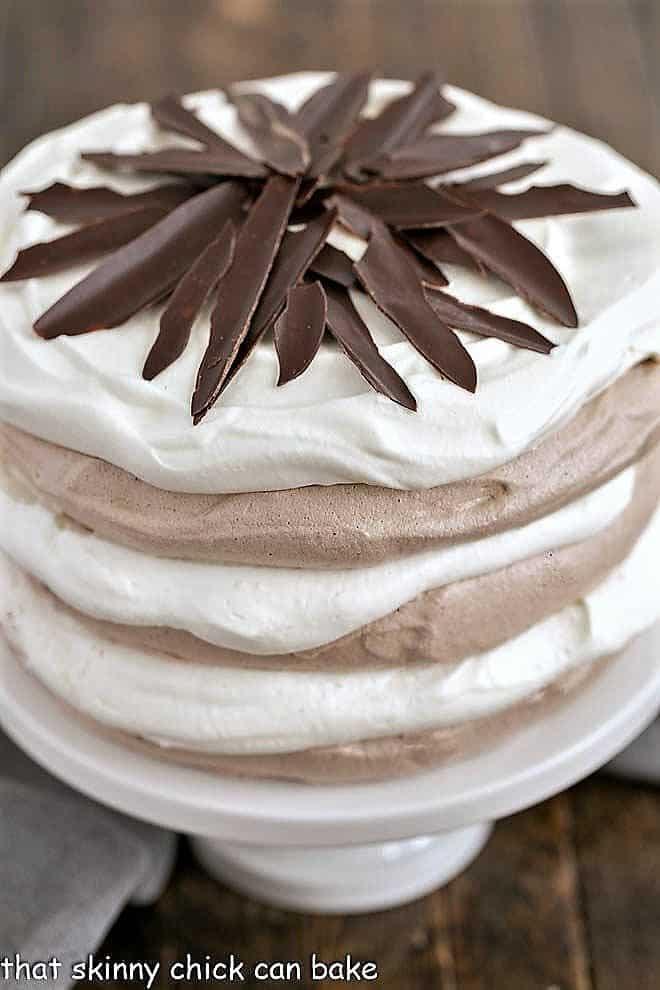 Close view of layered chocolate meringue cake