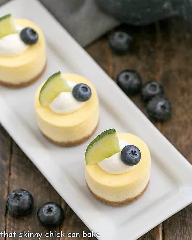 Mini Margarita Cheesecakes on a white rectangular tray viewed from above