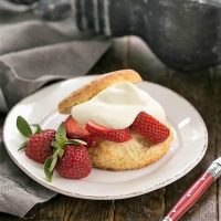 Strawberry Shortcakes with White Chocolate Whipped Cream on a white plate