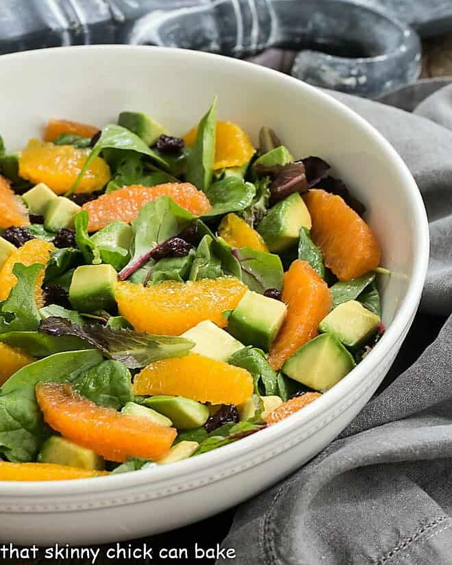 Cherry Orange Salad with Citrus Vinaigrette in a white serving bowl