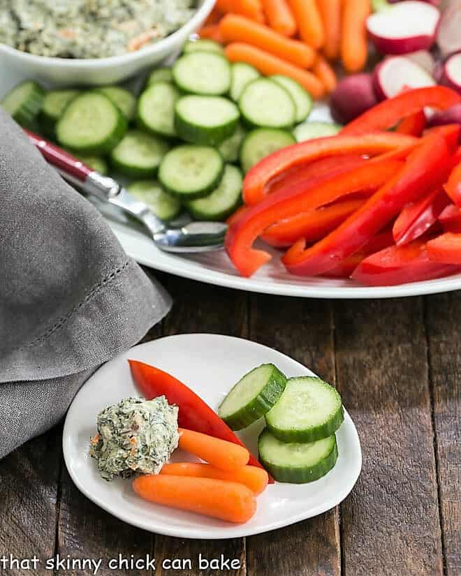 Small appetizer dish with a dollop of sour cream spinach dip and vegetables