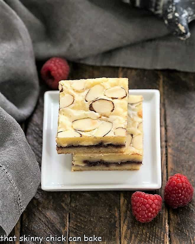 Raspberry Filled White Chocolate Bars stacked on a square white plate