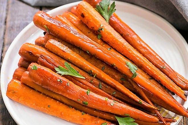 Honey Balsamic Roasted Carrots on a round, white ceramic plate