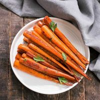 Honey Balsamic Roasted Carrots on a white ceramic plage