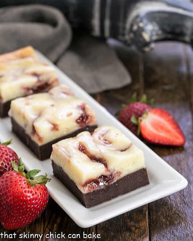 Strawberry Cheesecake Brownies on a rectangular white tray