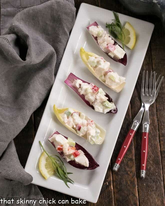 Overhead view of Lobster Salad in Endive Cups on a white rectangular tray