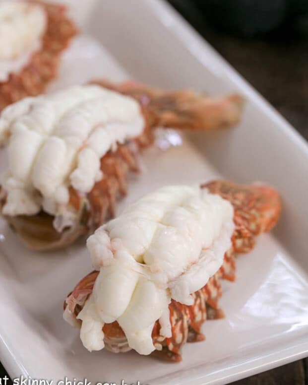 Cooked lobster tails on a white tray