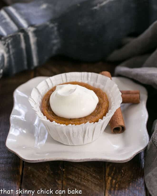 Pumpkin Pie Cupcake in a white paper wrapper on a square white plate