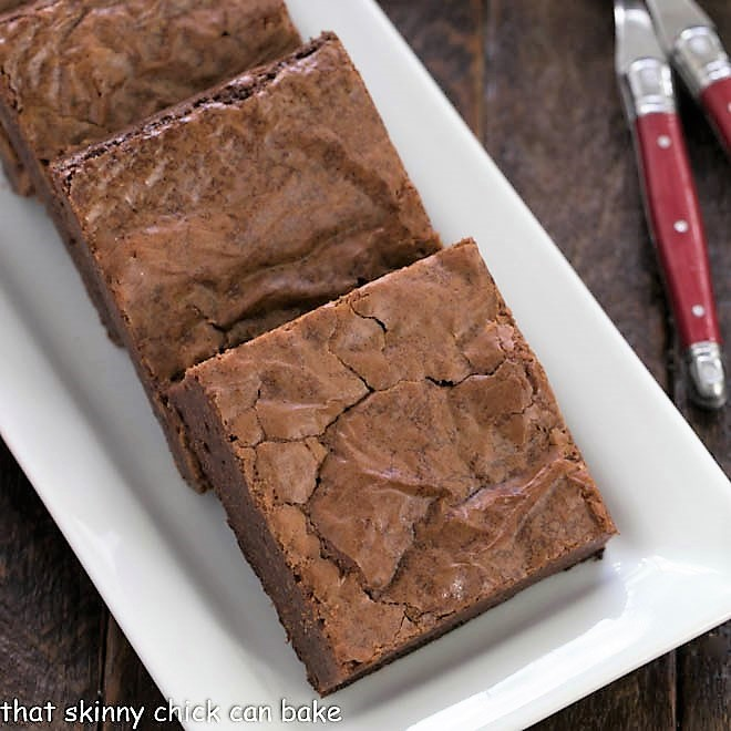 Closeup of Fudgy brownies on a white tray