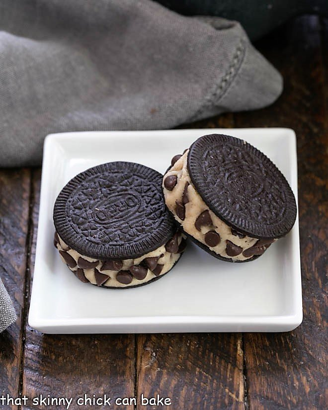 2 cookie dough stuffed Oreos on a square white plate
