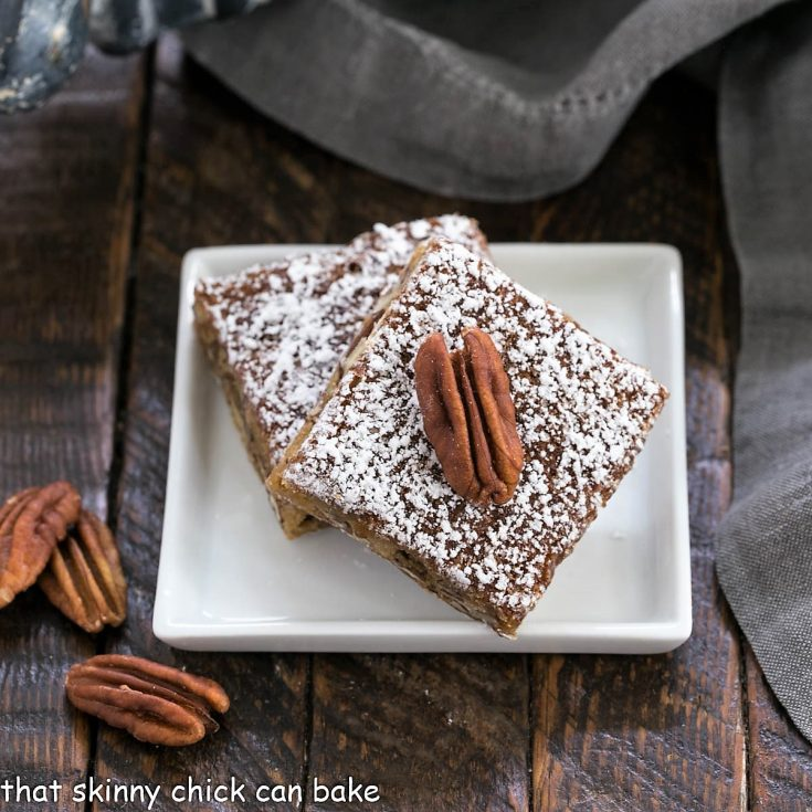 2 pecan bars on a small square plate